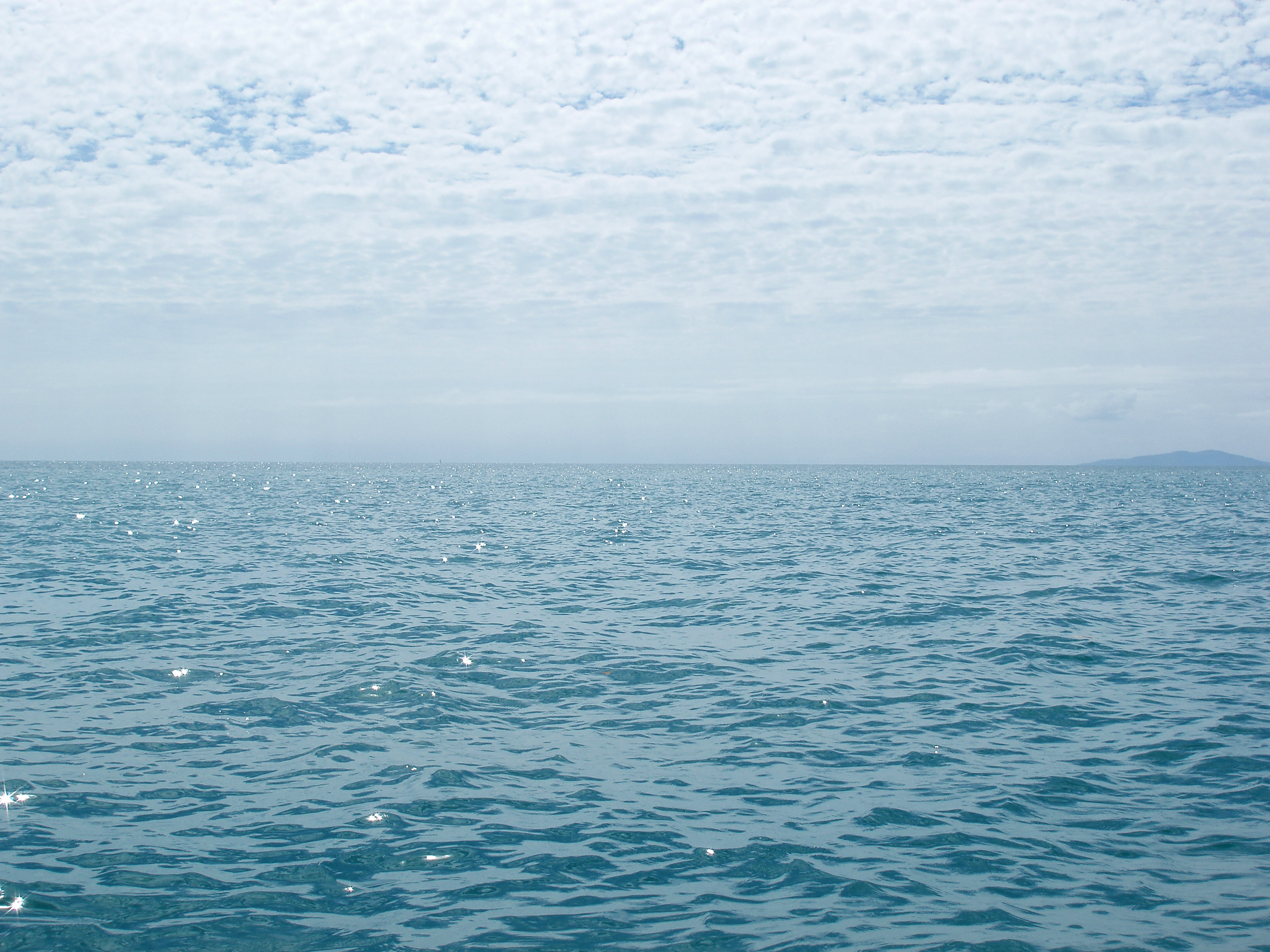 looking out at ripples on a calm ocean